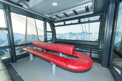 Interior of the cableway 3-S Pardatschgratbahn A2  with a view to the mountain landscape of Ischgl