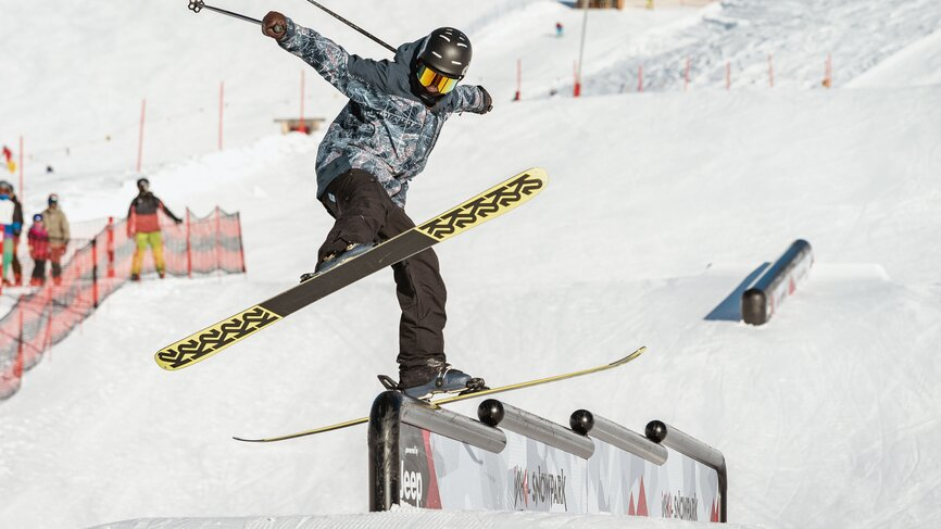 Skier has fun by making jumps in Parkarea 2 in Ischgl