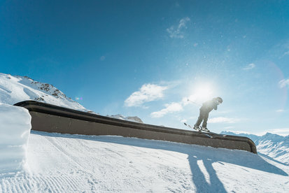 Skiers have really fun on a beautiful winter's day in the Snowpark Ischgl