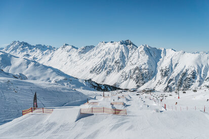 Ischgls Snowpark Check with the mountain backdrop in the background