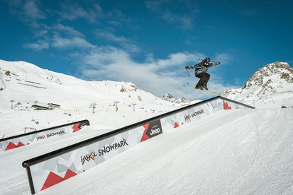 Skier have fun by making jumps in Parkarea in Ischgl