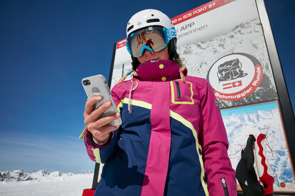 Skiers and snowboarders ride and track via smartphone the smuggler tours in Ischgl