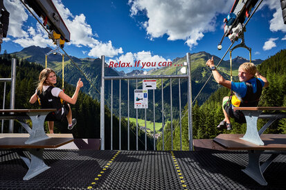 Holidaymakers are already in the starting position for their flight adventure with the Ischgl SKYFLY on sunny summer day